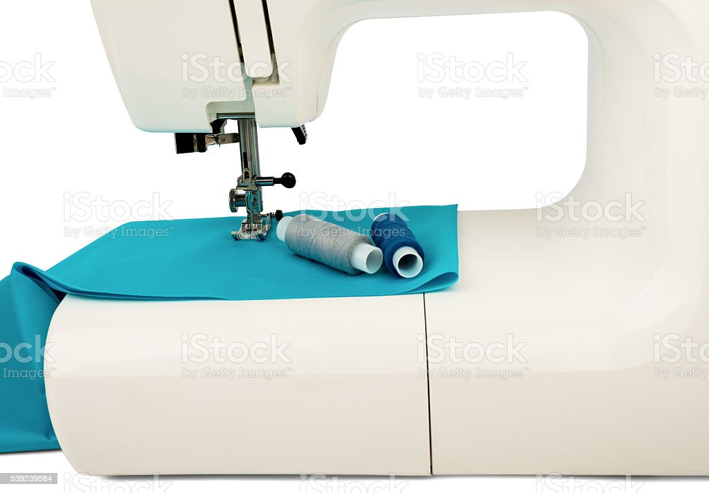Machine sews with blue textile fabric royalty-free stock photo