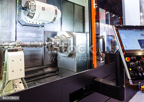 istock Machine tools with Computer Numerical Control CNC . CNC is the automation of machine tools that are operated by precisely programmed commands encoded on storage mediumas. 842428024