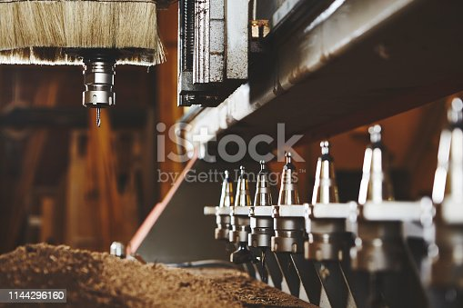 istock Machine working cnc, woodworking tool, computer numerical control. 1144296160
