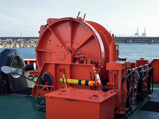 machinery on the front of the ship - cable winch stock photos and pictures
