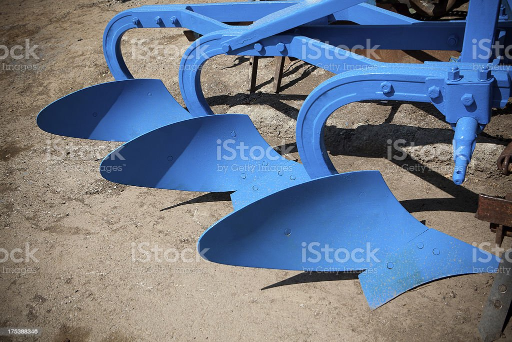 machinery to dig the soil machinery to dig the soil Agricultural Field Stock Photo