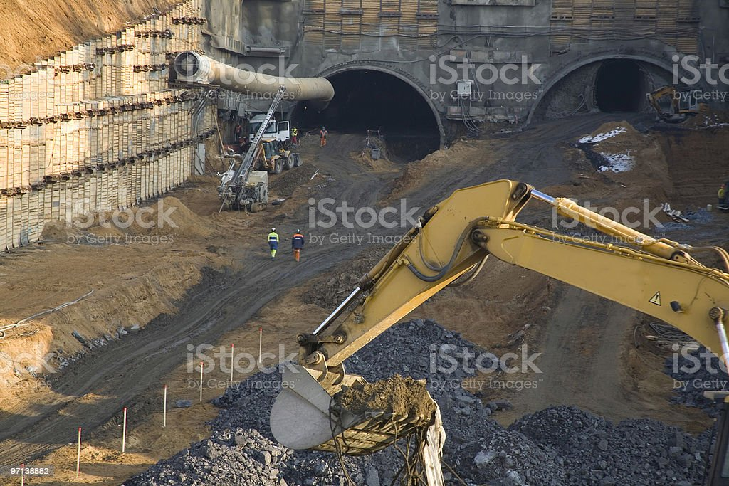 Machines working at construction site stock photo