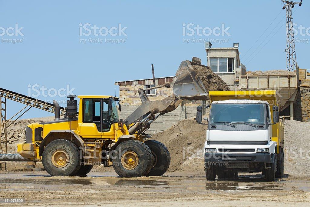 machines working at sand mine stock photo