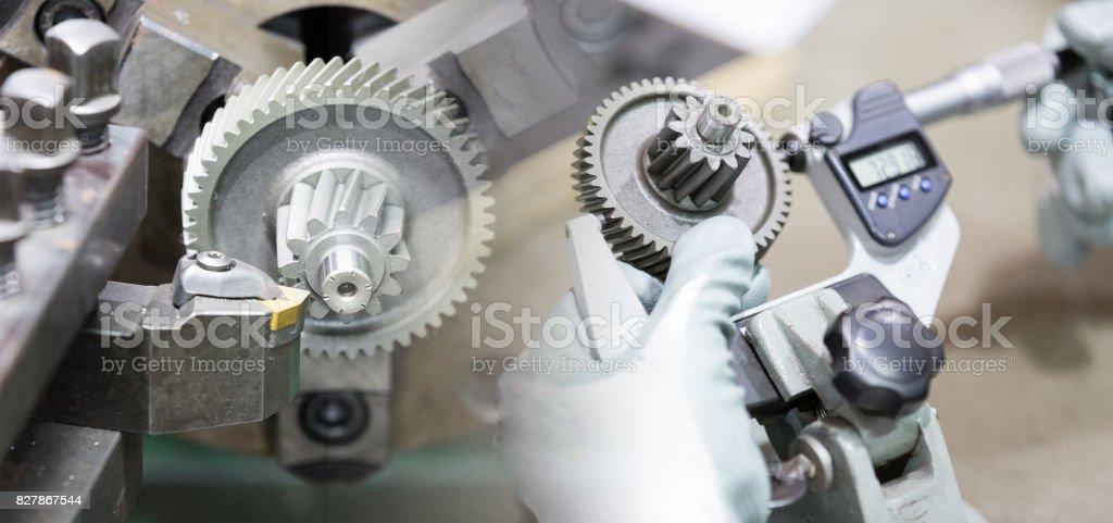machining automotive part by cnc turning machine stock photo