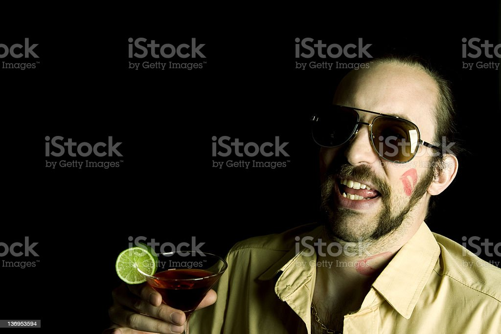 Macho drinking cocktail. royalty-free stock photo