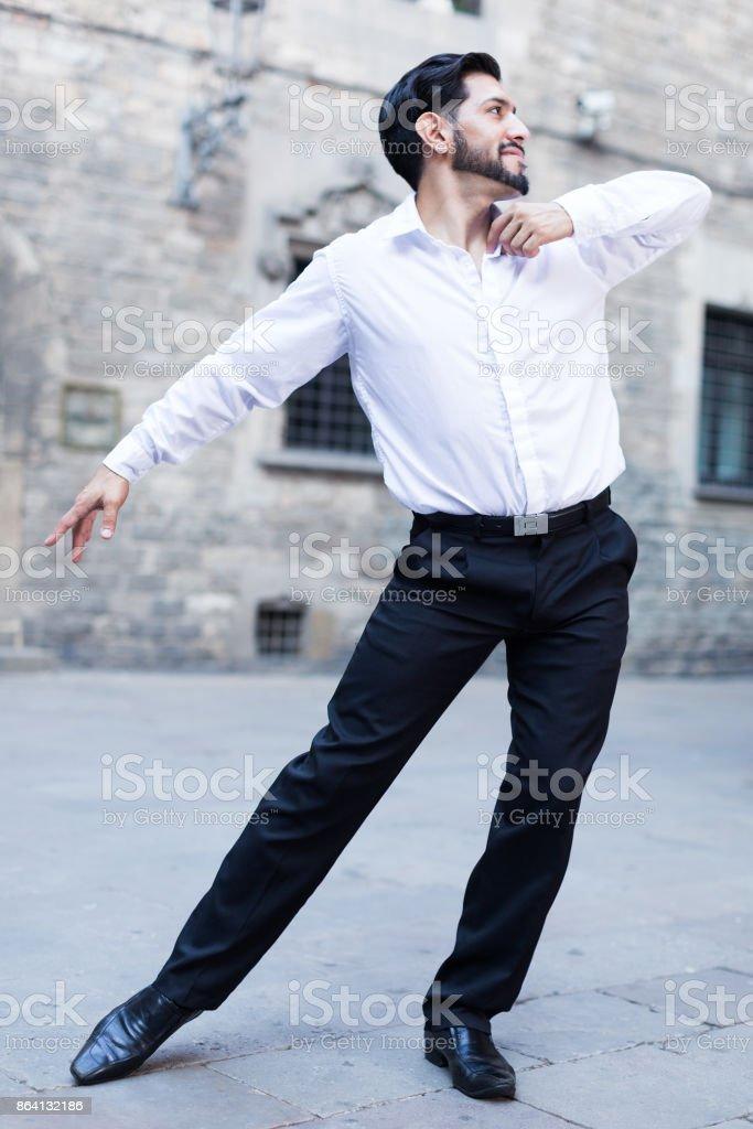 Macho man dancing solo outdoors royalty-free stock photo