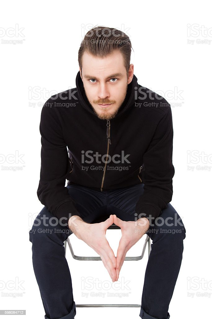 Macho man in a black sweater stock photo