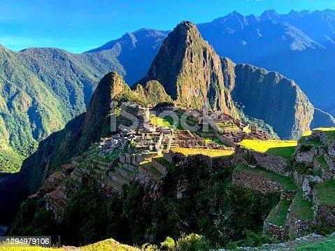 istock Machu Picchu ancient Inca city ruins in Andes mountains above Urubamba River Sacred Valley Aguas Calientes Cuzco region Peru, Lost city Incas Empire, Inca Trail panoramic view. 1294979106