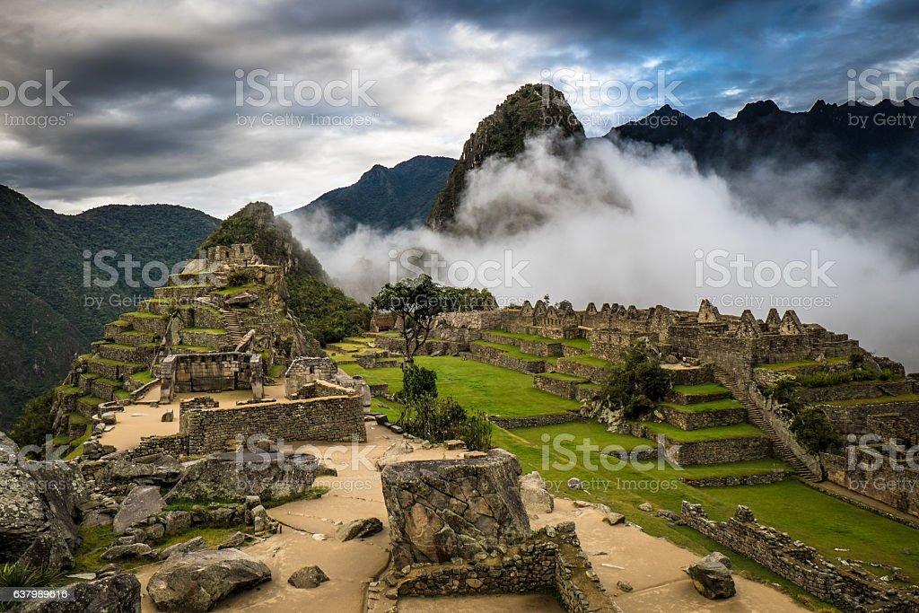 Machu Picchu at Sunrise and Clouds stock photo