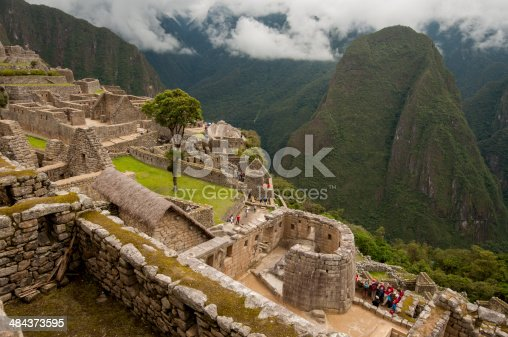 Ruins of Machu Picchu in the clouds, featuring the Temple of the Sun.