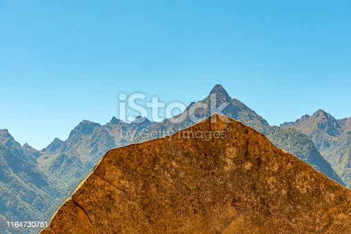 A sacred stone construction in Machu Picchu for its resemblance or imitation of the Huayna Picchu, Yanantin and Putukusi Andes mountain peaks, Cusco Region, Peru.