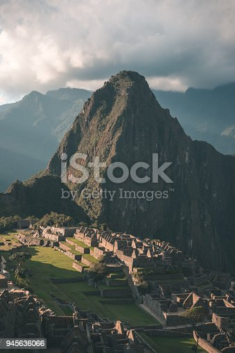 istock Machu Picchu terraces steep view from above to Urubamba valley below. Peru travel destination, tourism famous place. 945636066