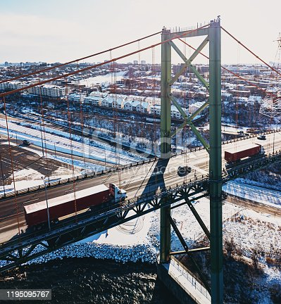 Aerial drone view of the A. Murray MacKay bridge spanning the narrows of Halifax Harbour.