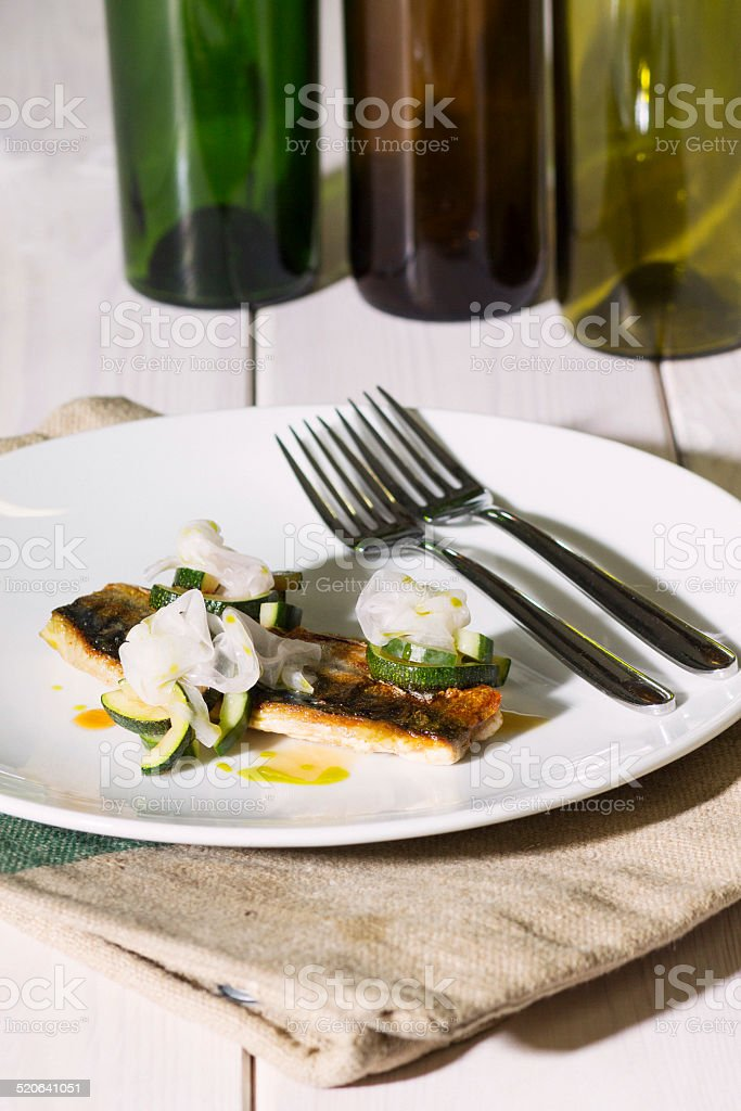 Mackerel fillet with zucchini and turnips stock photo