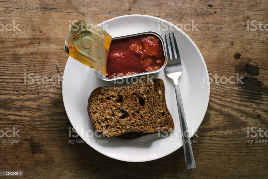 mackerel in tomatosauce for breakfast with toast bread stock photo