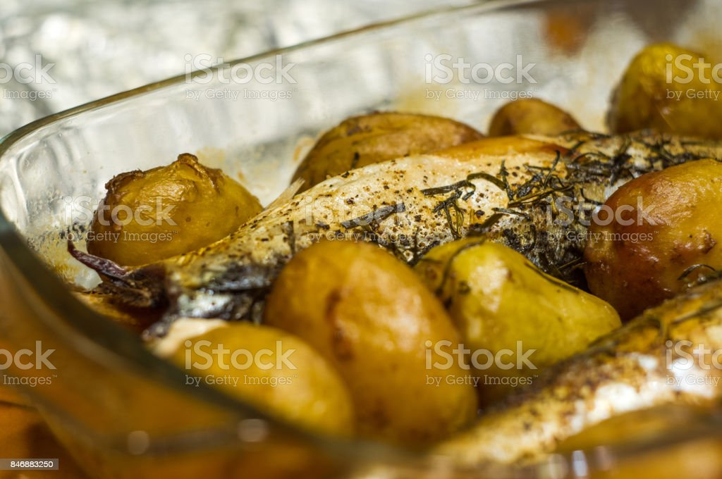 mackerel with potatoes baked in the oven stock photo