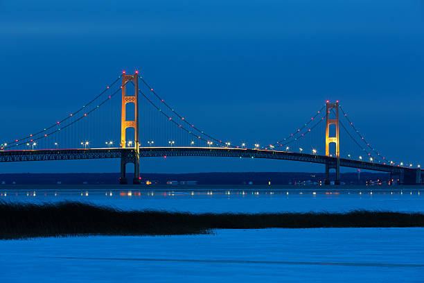 mackinac bridge at blue hour - mackinac island stock photos and pictures