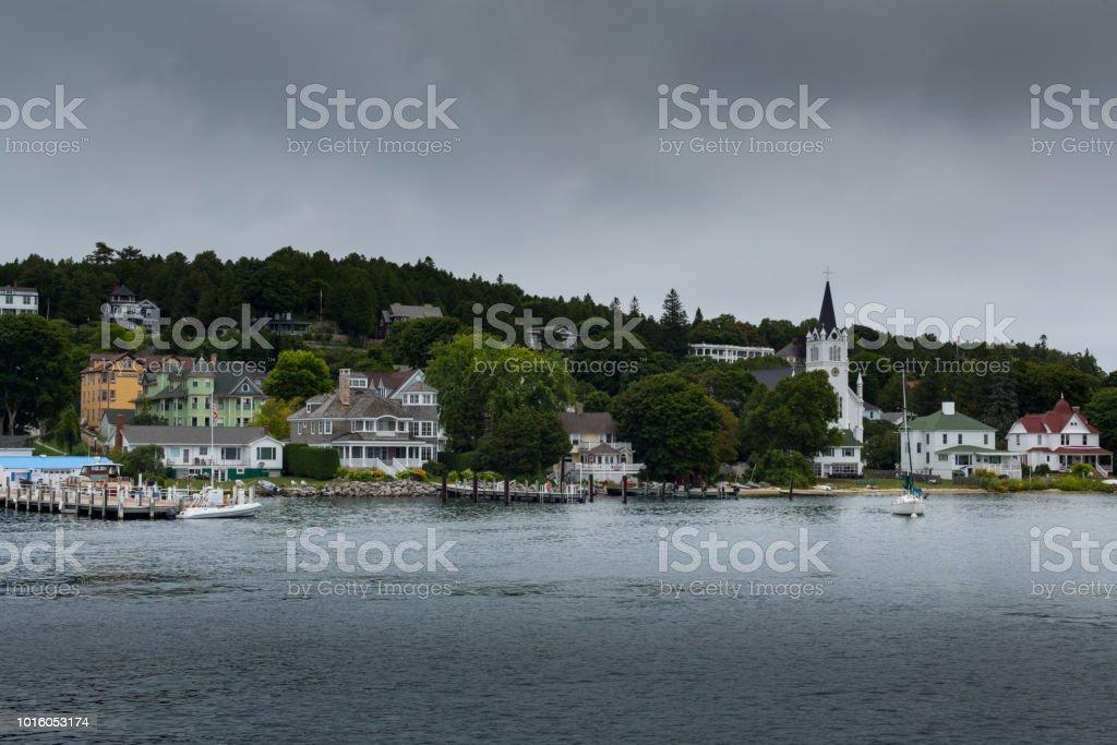 Mackinac Island harbor with calm water stock photo
