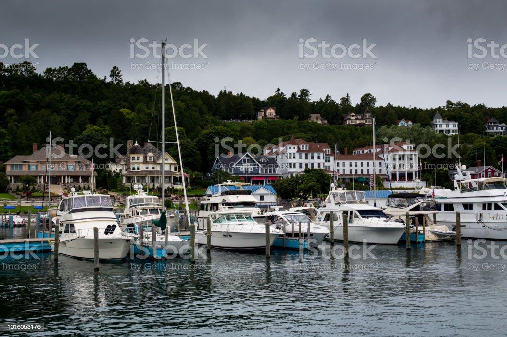 Mackinac Island harbor with docked boats stock photo