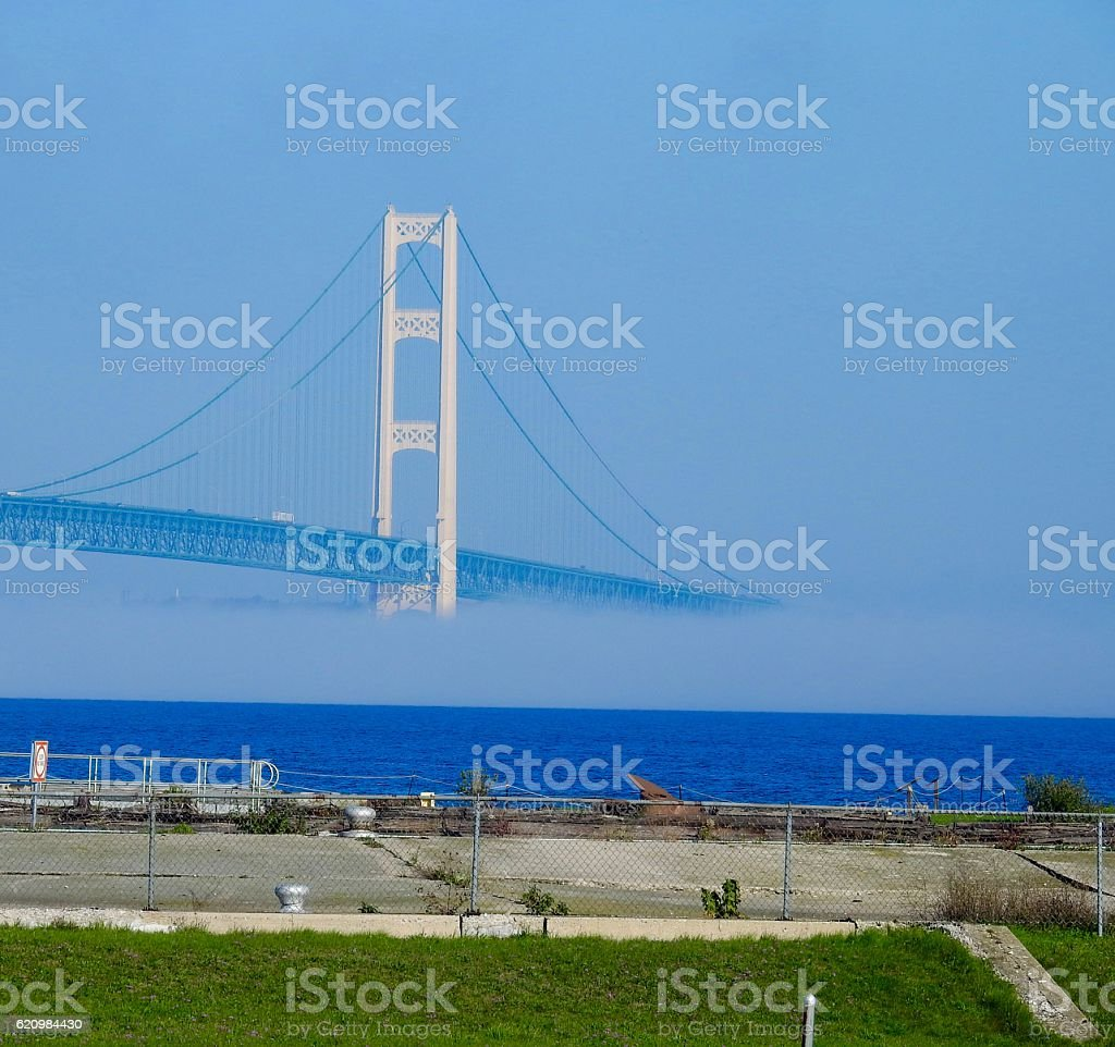 mackinaw bridge covered in fog stock photo