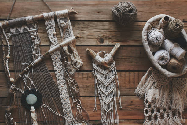 Macrame on a wooden table. Do it yourself. Top view.