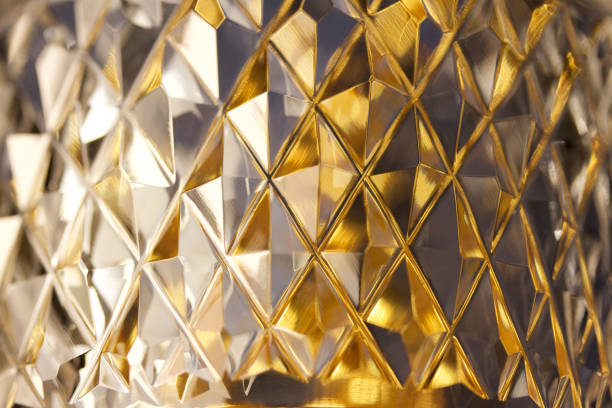 Macro abstract background of brilliant diamond facets on lead crystal stock photo
