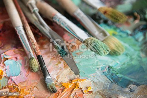 istock macro artist's palette, texture mixed oil paints in different co 577949446