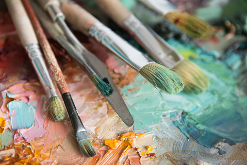 577949148 istock photo macro artist's palette, texture mixed oil paints in different co 577949446