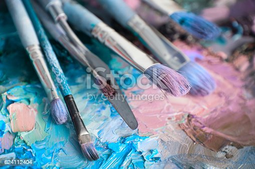 istock macro artist's palette, texture mixed oil paints in different co 624112404