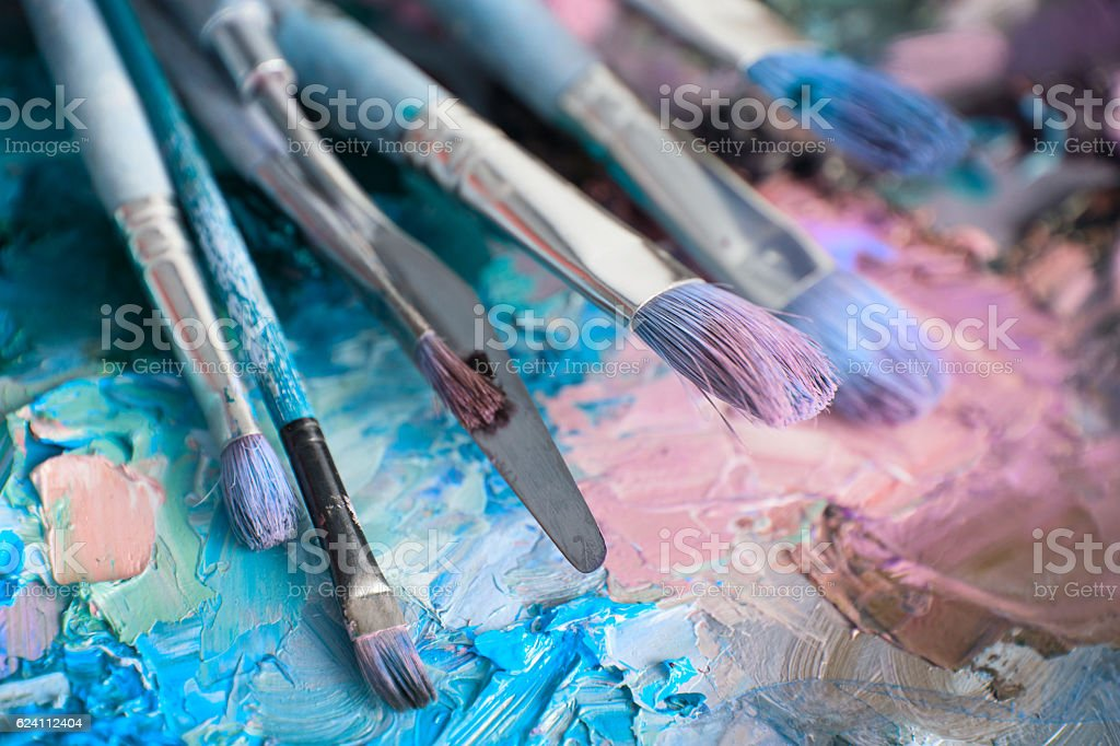 macro artist's palette, texture mixed oil paints in different co stock photo