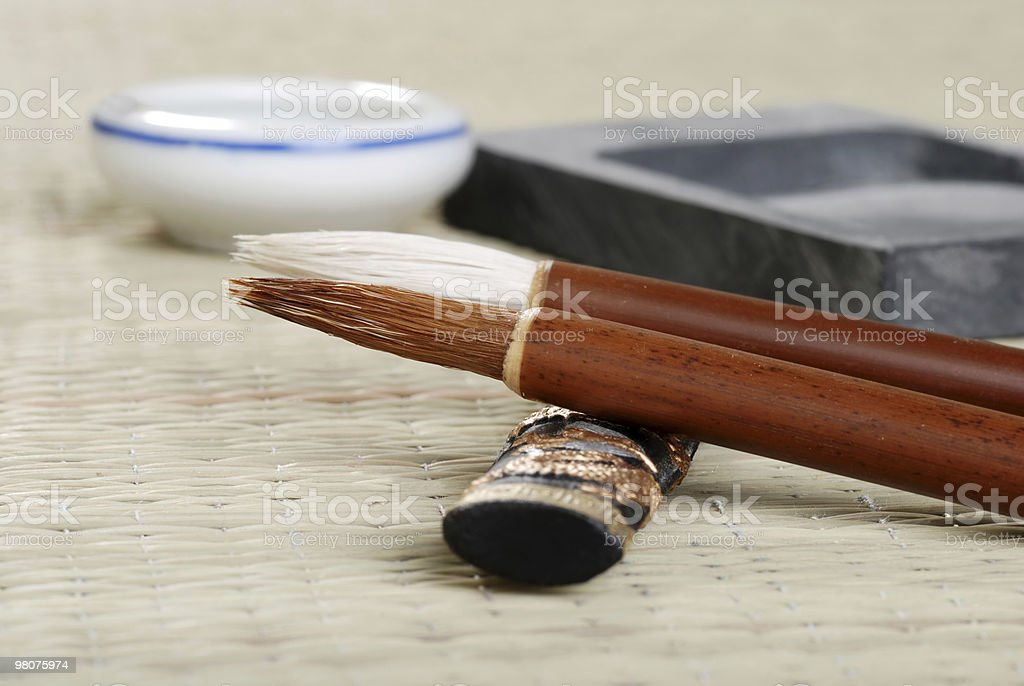 macro asian calligraphy brush with accessories royalty-free stock photo