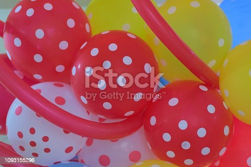 1136239089 istock photo Macro background texture of colorful rubber balloons 1093155296