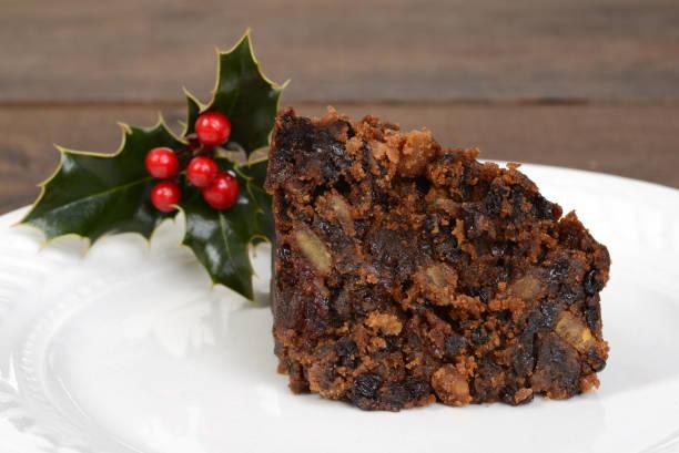 makro weihnachtspudding slice - apfelweinkuchen stock-fotos und bilder