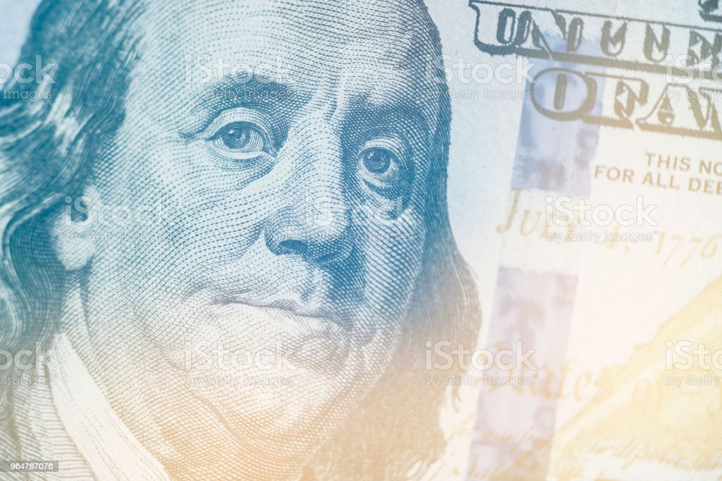 Macro close up of Ben Franklin's face on the US 100 dollar bill Light toning royalty-free stock photo
