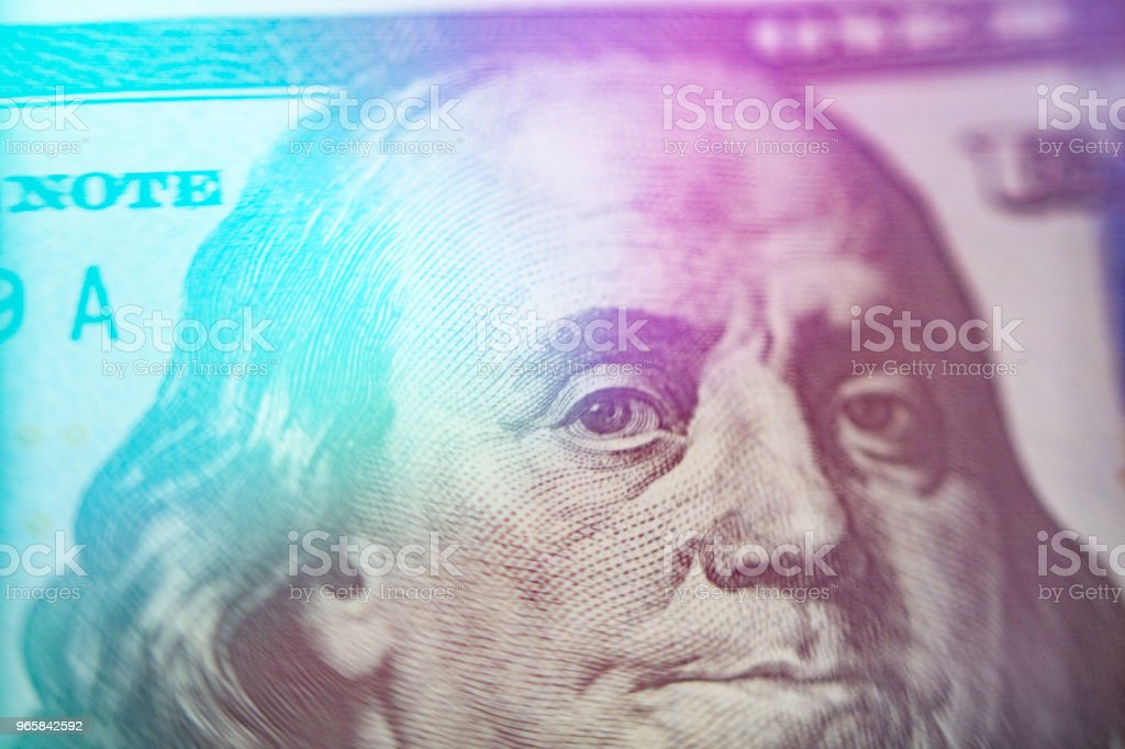 Macro close up of Ben Franklin's face on the US 100 dollar bill Light toning - Royalty-free Banking Stock Photo