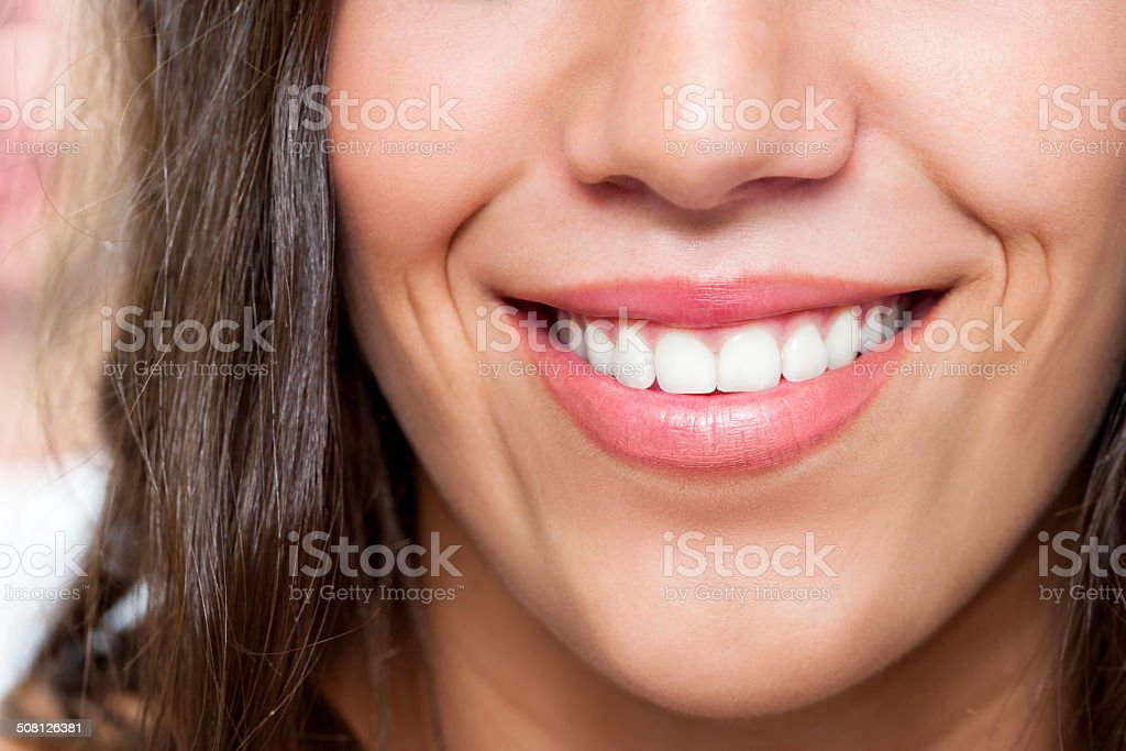 Macro close up of female smile stock photo