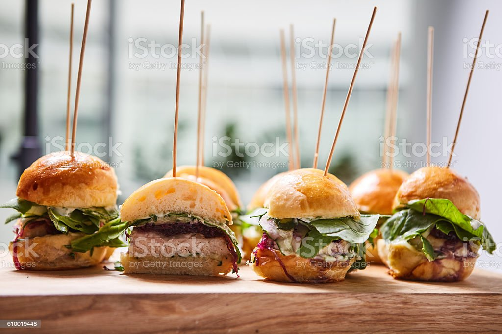 Macro close up of multiple appetizing mini chicken burgers stock photo