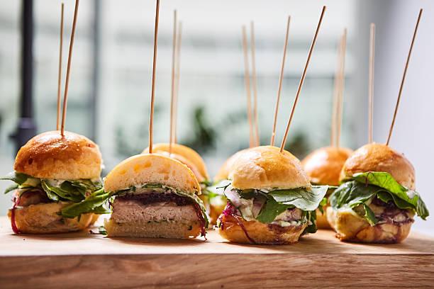 Macro close up of multiple appetizing mini chicken burgers - Photo