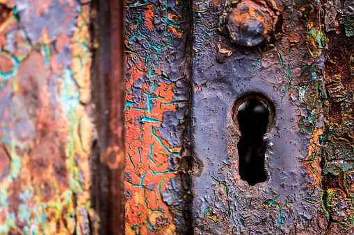Macro close up of old, rusted and weathered lock and keyhole