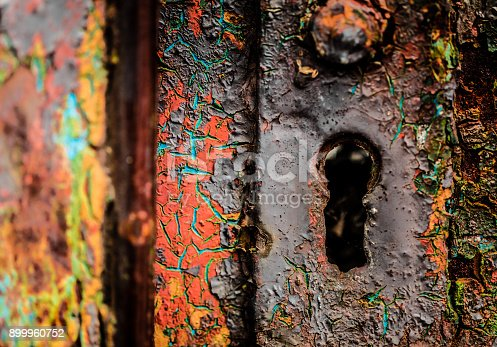 istock Macro close up of old, rusted and weathered lock and keyhole 899960752