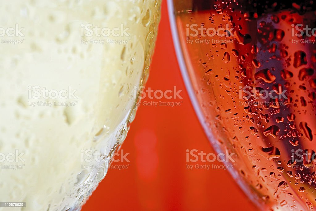 Macro close up wine glass and white and red or rose wine royalty-free stock photo