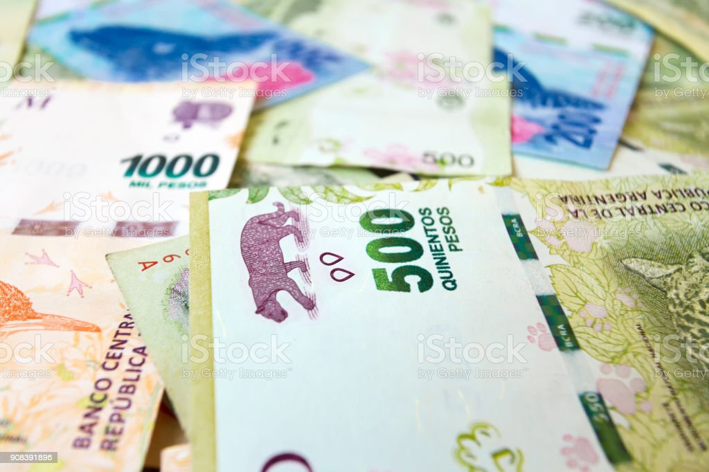 Macro close-up of 500 Argentine pesos bill with others of different values stock photo