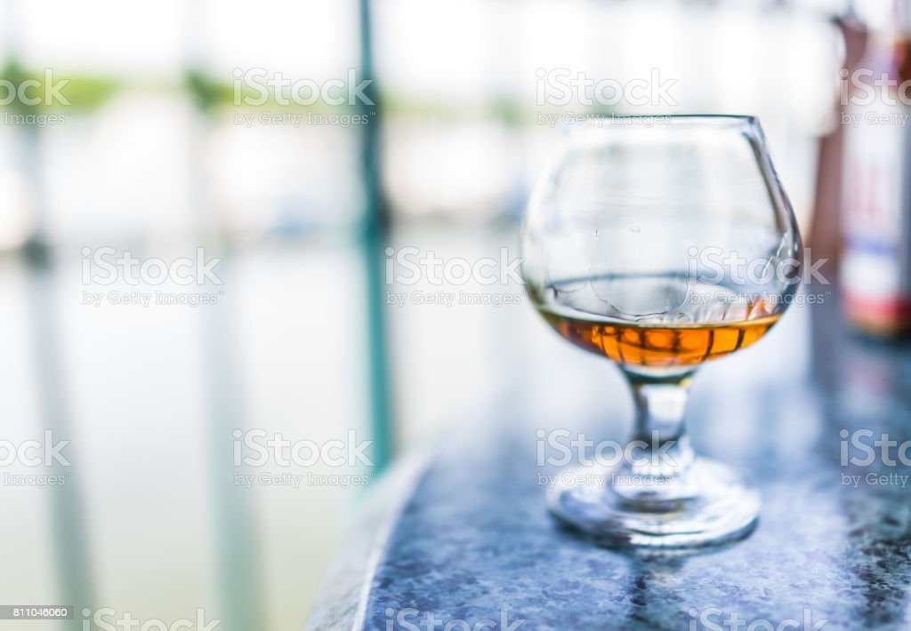 Macro closeup of amaretto, rum, or bourbon drink in glass stock photo
