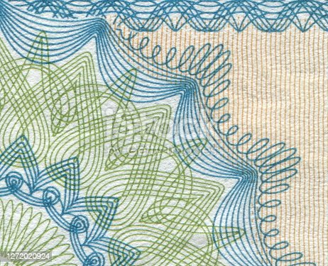 Macro close-up of banknote pattern design