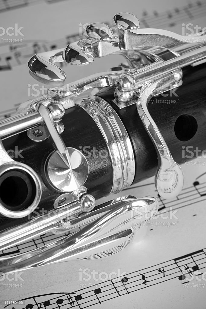 Macro close-up of brand new quality Clarinet on sheet music royalty-free stock photo