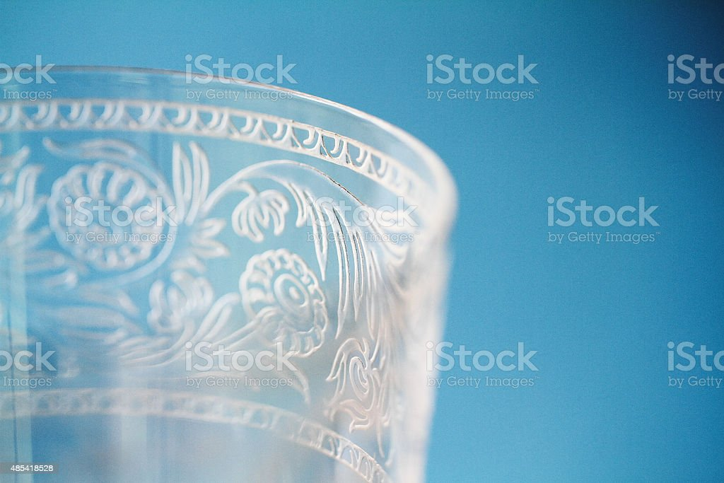Macro closeup of etching on wine goblet crystal glass stock photo