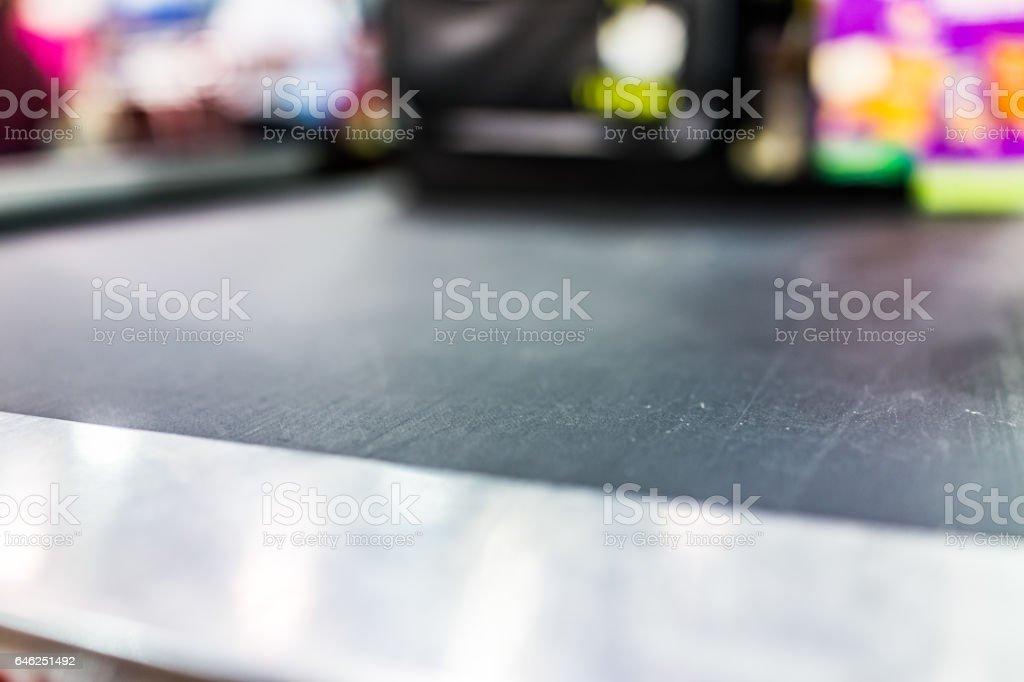Macro closeup of grocery store checkout aisle conveyor belt stock photo