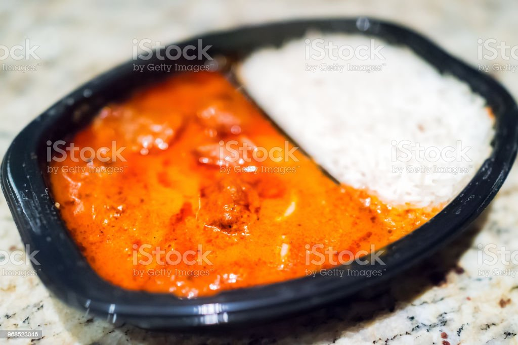 Macro Closeup Of Orange Red Curry Tikka Masala Sauce In Black