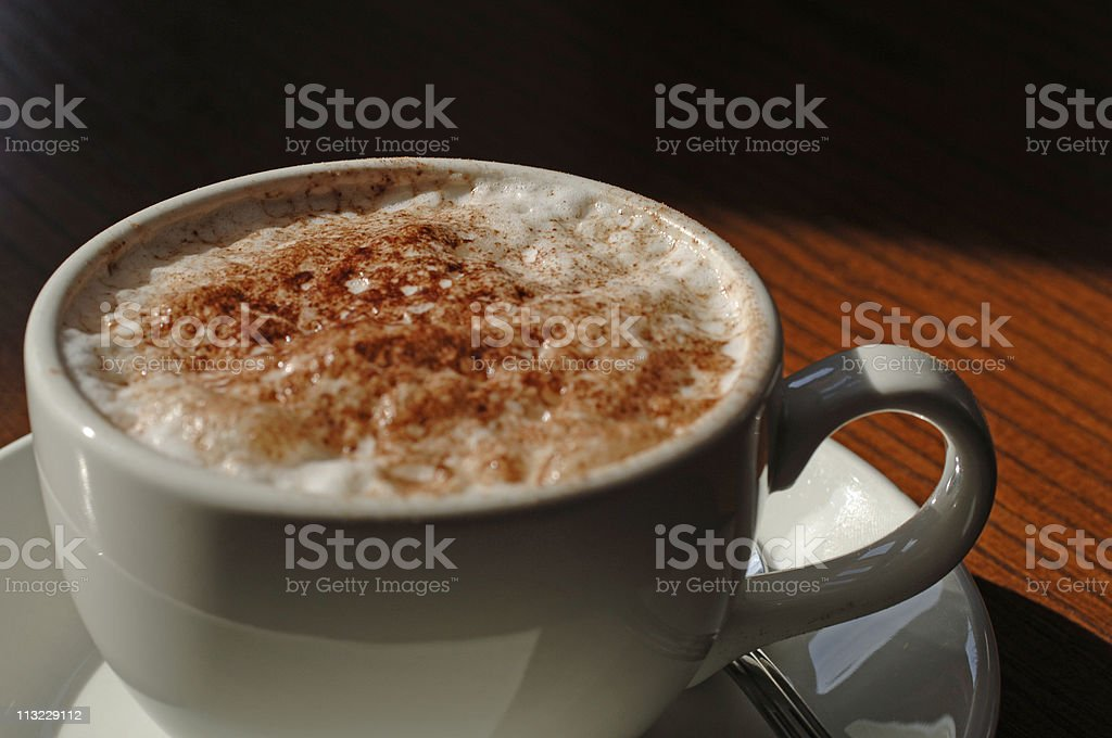 macro cup of cappuccino coffee royalty-free stock photo