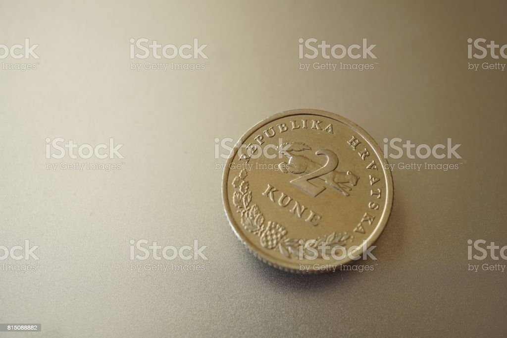 Macro detail of a metal Croatian coin (2 Kune) on the shiny silver metal background stock photo